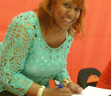 K. Ceres Wright signing COG